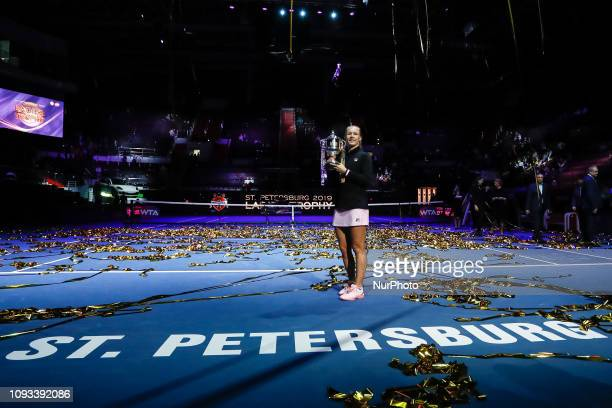 Kiki Bertens of Netherlands celebrates with the trophy after her WTA St Petersburg Ladies Trophy 2019 tennis tournament final match against Donna...