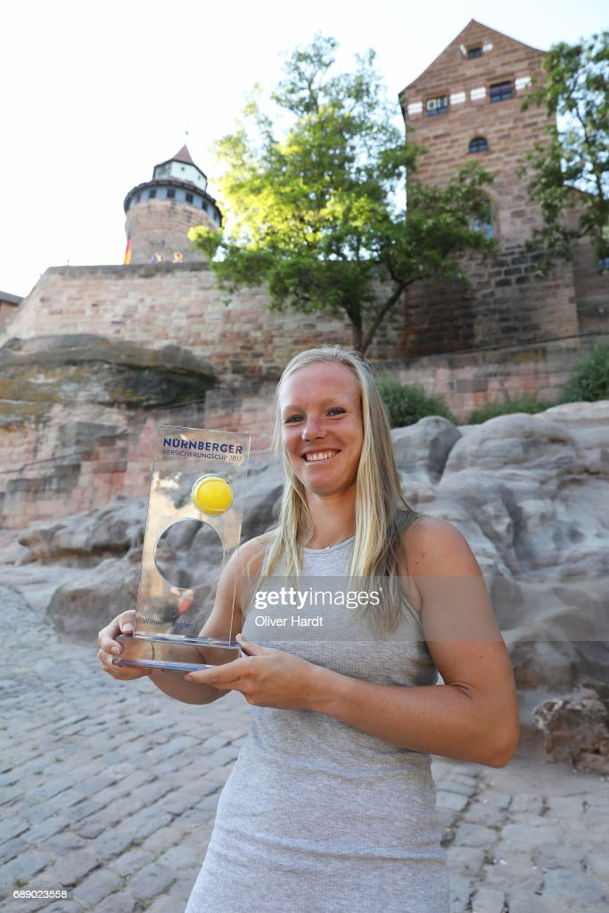 Kiki Bertens of Netherlands celebrates with the trophy after winning the final match against Barbora Krejcikova of Czech Republic at the town's landmark Kaiserburg during the WTA Nuernberger Versicherungscup on May 27, 2017 in Nuernberg, Germany.