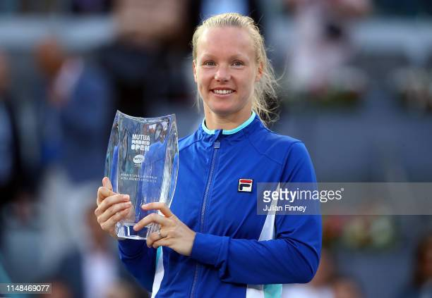 Kiki Bertens of Netherlands celebrates with the winners trophy after her final win against Simona Halep of Romania during day eight of the Mutua...