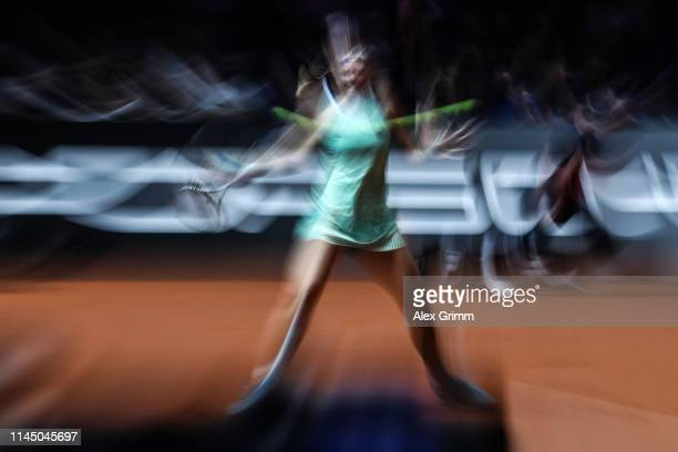 Kiki Bertens of Netherlands plays a forehand during her round of 16 match against Belinda Bencic of Switzerland on day 4 of the Porsche Tennis Grand...