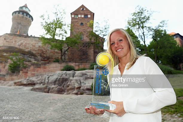 Kiki Bertens of Netherlands poses in front of the castle after winning the Nuernberger Versicherungscup 2016 on May 21 2016 in Nuremberg Germany