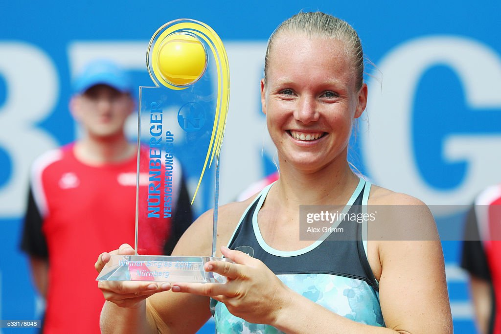 Kiki Bertens of Netherlands poses with the trophy after winning her singles final match against Mariana Duque-Marino of Colombia on day eight of the Nuernberger Versicherungscup 2016 on May 21, 2016 in Nuremberg, Germany.
