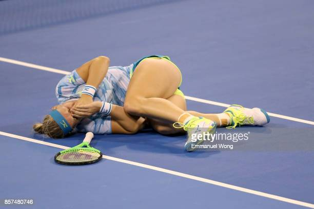 Kiki Bertens of Netherlands reacts after an injury during doubles match with Julia Goerges of Germany against Annalena Groenefeld of Germany and...