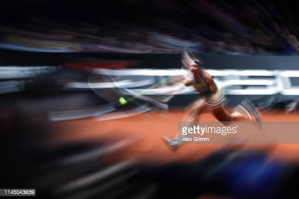 Kiki Bertens of Netherlands stretches for a ball during her round of 16 match against Belinda Bencic of Switzerland on day 4 of the Porsche Tennis...