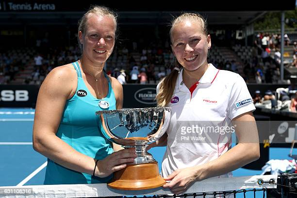 Kiki Bertens of the Netherlands and Johanna Larsson of Sweden hold the trophy after winning the womens doubles final against Demi Schuurs of the...
