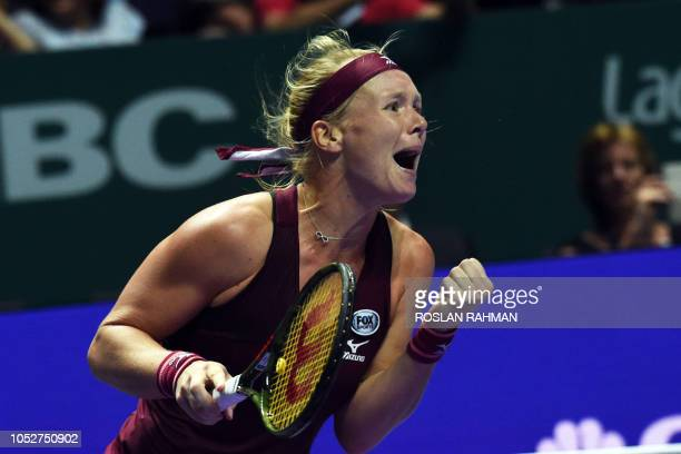 Kiki Bertens of the Netherlands celebrates after defeating Germany's Angelique Kerber during their singles match at the WTA Finals tennis tournament...