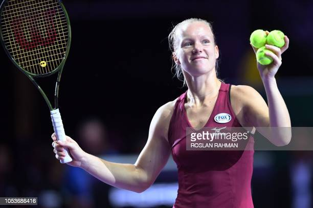 Kiki Bertens of the Netherlands celebrates after winning against Japan's Naomi Osaka who retired with injury during their singles match at the WTA...