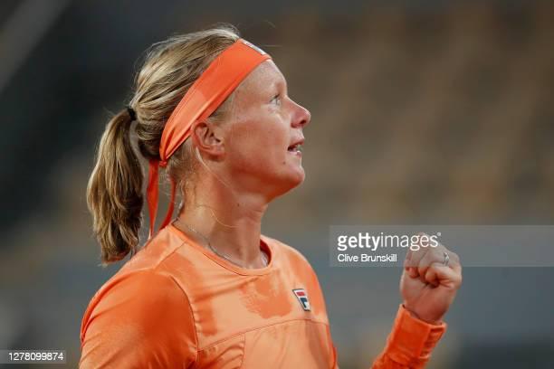Kiki Bertens of the Netherlands celebrates after winning match point during her Women's Singles third round match against Katerina Siniakova of Czech...