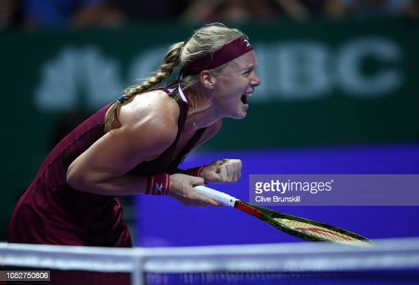 Kiki Bertens of the Netherlands celebrates match point in her singles match against Angelique Kerber of Germany during day 2 of the BNP Paribas WTA...