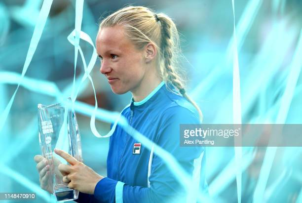 Kiki Bertens of The Netherlands celebrates victory with the trophy during the ladies singles final against Simona Halep of Romania during day eight...