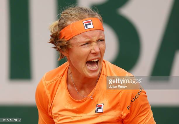 Kiki Bertens of the Netherlands celebrates winning the first set during her Women's Singles second round match against Sara Errani of Italy on day...
