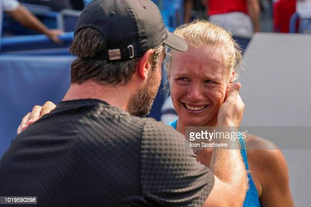 Kiki Bertens of the Netherlands has an emotional moment with her coach Raemon Sluiter after defeating Simona Halep of Romania after the Western...