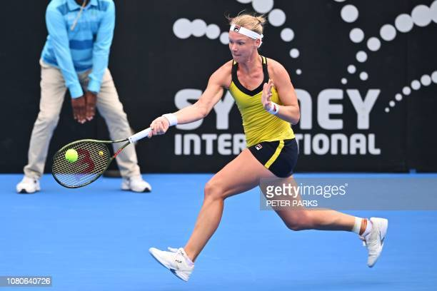 Kiki Bertens of the Netherlands hits a return to Australia's Ashleigh Barty during their women's singles semi-final match at the Sydney International...