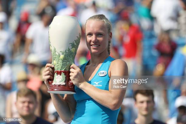 Kiki Bertens of the Netherlands holds the trophy after defeating Simona Halep of Romania during the womens final during Day 9 of the Western and...