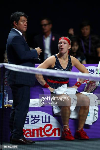 Kiki Bertens of the Netherlands is attended to by tournament staff during her Women's Singles match against Belinda Bencic of Switzerland on Day Five...