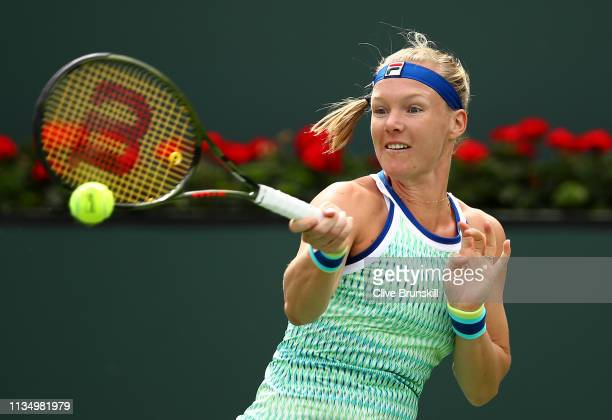 Kiki Bertens of the Netherlands plays a forehand against Johanna Konta of Great Britain during their women's singles third round match on day seven...