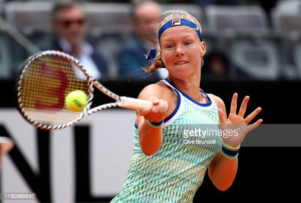 Kiki Bertens of the Netherlands plays a forehand against Johanna Konta of Great Britain in their semifinal match during day seven of the...