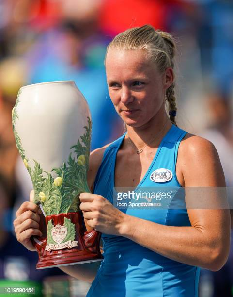 Kiki Bertens of the Netherlands poses with the trophy after defeating Simona Halep of Romania in the Western Southern Open singles final at the...