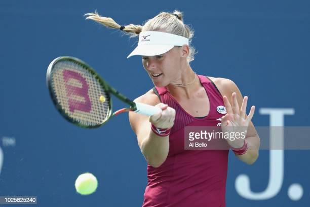 Kiki Bertens of the Netherlands returns the ball during her women's singles third round match against Marketa Vondrousova of Czech Republic on Day...