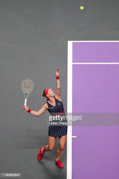 Kiki Bertens of the Netherlands serves against Belinda Bencic of Switzerland during their Women's Singles match on Day Five of the 2019 Shiseido WTA...