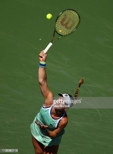 Kiki Bertens of the Netherlands serves against Garbine Muguruza of Spain during their women's singles fourth round match on day nine of the BNP...
