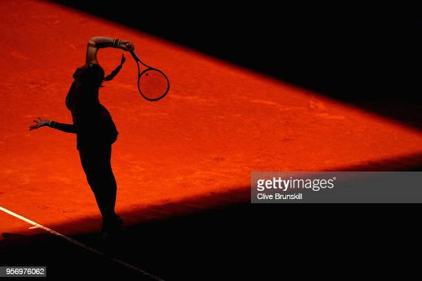 Kiki Bertens of the Netherlands serves against Maria Sharapova of Russia in their quarter final match during day six of the Mutua Madrid Open tennis...