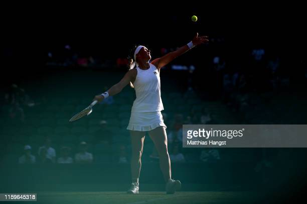 Kiki Bertens of The Netherlands serves in her Ladies' Singles first round match against Mandy Minella of Luxembourg during Day two of The...