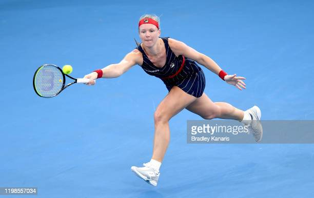 Kiki Bertens of the Netherlands stretches out to play a forehand in her match against Naomi Osaka of Japan during day five of the 2020 Brisbane...