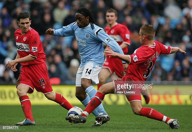 Kiki Musampa of Manchester City takes on Lee Cattermole and Stewart Downing of Middlesbrough during the Barclays Premiership match between Manchester...