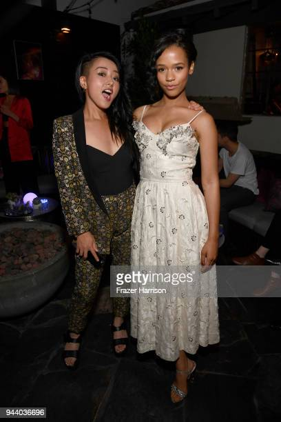 Kiki Sukezane and Taylor Russell attend the Premiere Of Netflix's 'Lost In Space' Season 1 After Party at Le Jardin LA on April 9 2018 in Los Angeles...