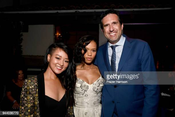 Kiki SukezaneTaylor Russell Zack Estrin attend the Premiere Of Netflix's 'Lost In Space' Season 1 After Party at Le Jardin LA on April 9 2018 in Los...