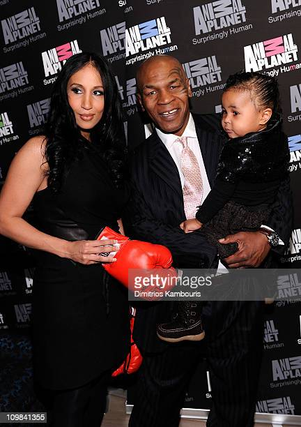 Kiki Tyson Mike Tyson and Milan Tyson attend Animal Planet's Taking On Tyson premiere Party at the Gansevoort Hotel Park Avenue on March 2 2011 in...
