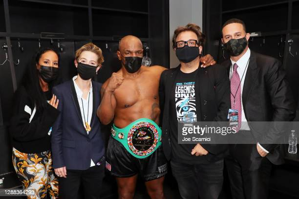 Kiki Tyson, Sophie Watts, Mike Tyson, John Ryan, and Azheem Spicer pose in the locker room during Mike Tyson vs Roy Jones Jr. Presented by Triller at...