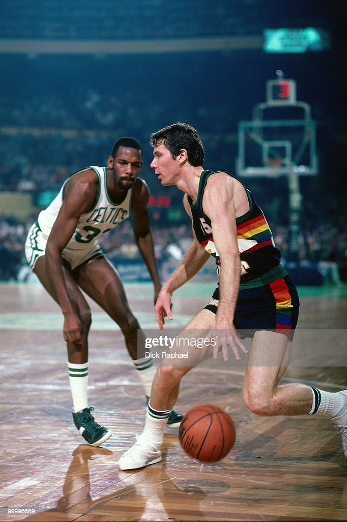 Kiki Vandeweghe #55 of the Denver Nuggets makes a move against Cedric Maxwell #31 of the Boston Celtics during a game played in 1983 at the Boston Garden in Boston, Massachusetts.