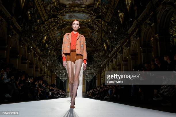 Kiki Willems walks the runway during the Dries Van Noten show as part of the Paris Fashion Week Womenswear Spring/Summer 2018 on September 27 2017 in...
