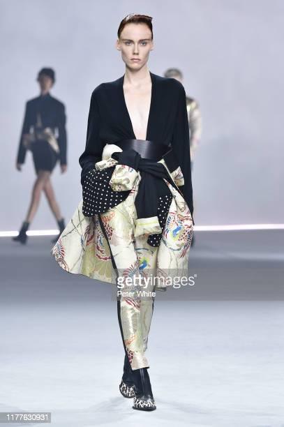 Kiki Willems walks the runway during the Haider Ackermann Womenswear Spring/Summer 2020 show as part of Paris Fashion Week on September 28, 2019 in...