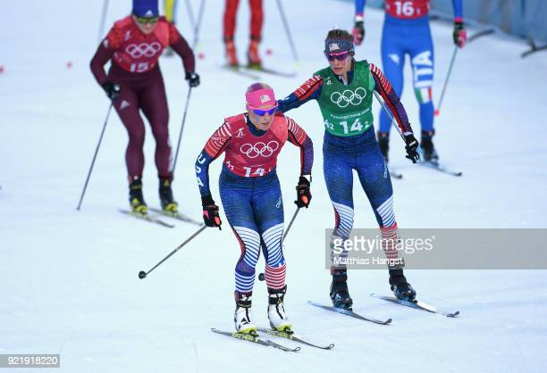 Kikkan Randall of the United States and Jessica Diggins of the United States handover during the Cross Country Ladies' Team Sprint Free semi final on...