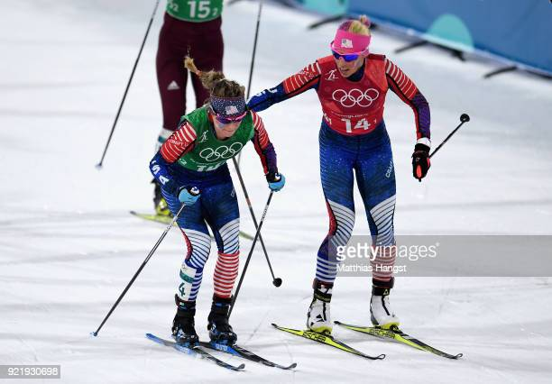 Kikkan Randall of the United States and Jessica Diggins of the United States handover during the Cross Country Ladies' Team Sprint Free Final on day...
