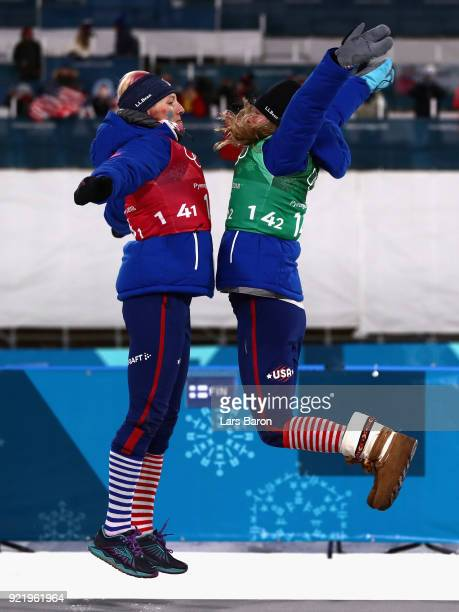 Kikkan Randall of the United States and Jessica Diggins of the United States celebrate on the podium during the victory ceremony for the Cross...