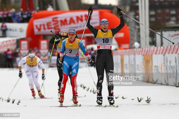 Kikkan Randall of the United States celebrates winning the women's 09 km sprint of the FIS Cross Country World Cup at the Dusseldorf city circuit on...