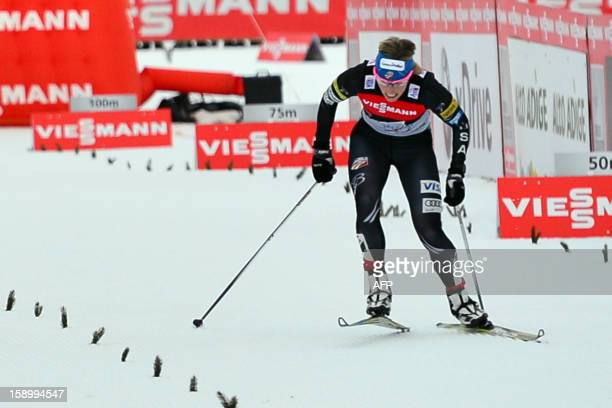 Kikkan Randall of the US competes in the fourth stage of the Ladie's Tour de Ski a 15 km free pursuit in Toblach on January 3 2013 Polish Justyna...