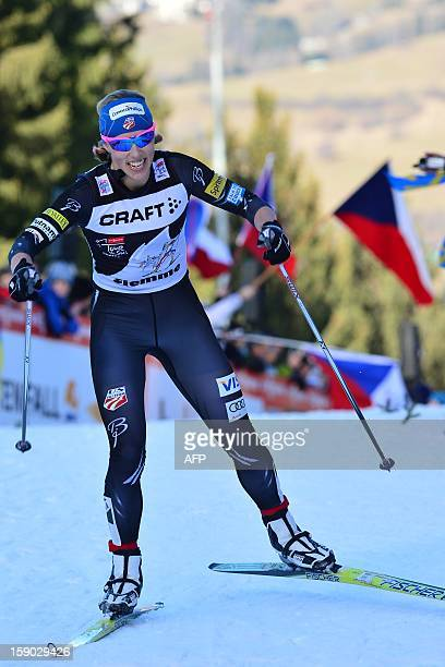 Kikkan Randall of USA crosses the finish line of the women's 9km free final climb pursuit of the Tour de Ski in Val di Fiemme on January 6 2013...