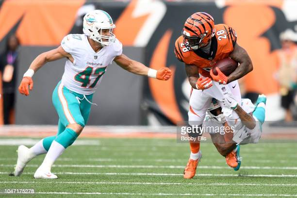 Kiko Alonso of the Miami Dolphins and Torry McTyer combine to tackle Joe Mixon of the Cincinnati Bengals during the first quarter at Paul Brown...