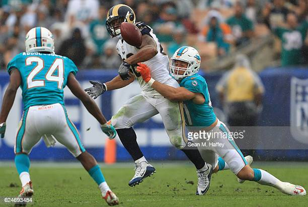 Kiko Alonso of the Miami Dolphins causes Lance Kendricks of the Los Angeles Rams to fumble the ball during the third quarter of the game at Los...