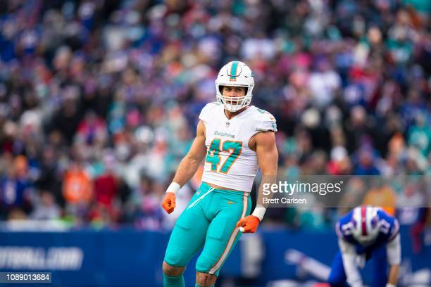 Kiko Alonso of the Miami Dolphins celebrates a defensive stop during the first quarter against the Buffalo Bills at New Era Field on December 30,...