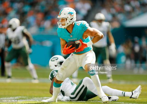 Kiko Alonso of the Miami Dolphins intercepts a pass thrown by Sam Darnold of the New York Jets in the first quarter of their game at Hard Rock...