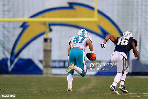 Kiko Alonso of the Miami Dolphins intercepts and returns it for a touchdown as Tyrell Williams of the San Diego Chargers chases during the second...