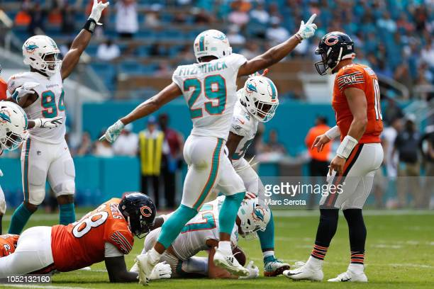 Kiko Alonso of the Miami Dolphins recovers a fumble by Jordan Howard of the Chicago Bears in the second quarter of the game at Hard Rock Stadium on...