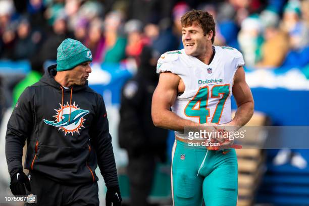 Kiko Alonso of the Miami Dolphins walks off the field after being ejected during the third quarter against the Buffalo Bills at New Era Field on...