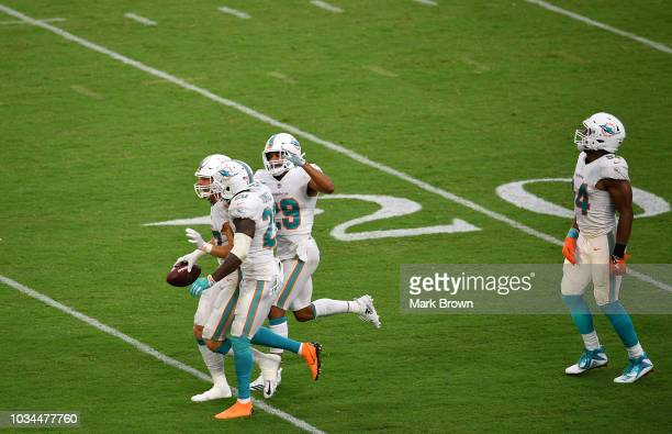 Kiko Alonso Reshad Jones Minkah Fitzpatrick and Robert Quinn of the Miami Dolphins celebrate after Kiko Alonso made an interception during the game...